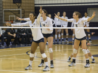 FILE PHOTO: NATE MOULTON/THE HOYA Junior middle blocker Ashlie Williams, left, led the Georgetown volleyball team with 25 kills and 33 digs over the team's first three games. Williams, who has played as a middle blocker throughout her college career, has also played as a right-side hitter this season.