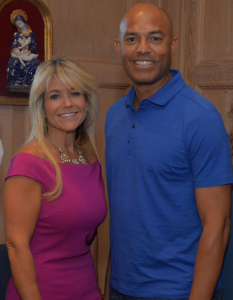 COURTESY JOHN VECCHIOLLA Mariano Rivera (right) is MLB's all-time leader with 652 saves. Rivera, pictured with College of New Rochelle President Judith Huntington, recently bought a church in the New York town.