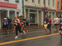 courtney klein/the hoya Runners stream down M Street in Georgetown as part of the Marine Corps Marathon, which saw 30,000 racers, many from the university, traverse the District.