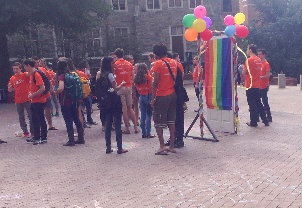 ISABEL BINAMIRA/THE HOYA GU Pride organized a celebration of Coming Out Day in Red Square last Friday to kick off the 11th annual OUTober, which includes 15 other events organized by the LGBTQ Resource Center throughout October and the first three weeks of November.