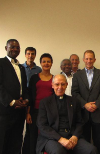 TWITTER Rev. François Kabore, S.J., far left, and Fr. Matthew Carnes, S.J., far right, travelled to Rome two weeks ago as part of a Jesuit task force.