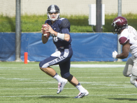 FILE PHOTO: NAAZ MODAN/THE HOYA Senior quarterback Kyle Nolan threw for 194 yards and recorded a rushing touchdown in Georgetown's 17-13 loss to Colgate. Nolan has 1484 passing yards and 10 passing touchdowns so far in the 2015 season.
