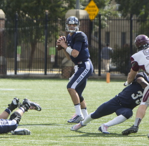 FILE PHOTO: NAAZ MODAN/THE HOYA Senior quarterback Kyle Nolan threw for 94 yards, including a 40-yard touchdown to junior wide receiver Justin Hill, in the Hoyas' win.