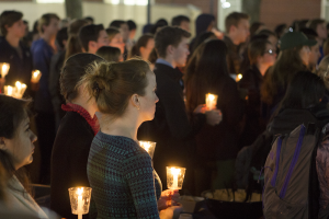 ISABEL BINAMIRA/THE HOYA Students, faculty and staff gather in Dahlgren Quadrangle for an interfaith reflection following attacks in Baghdad, Beirut and Paris.