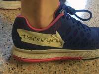 COURTESY JAKE MAXMIN A student activist tapes over the Nike logo on a shoe to protest unethical business practices. A letter sent to University President John J. DeGioia asked the university to sever ties with the athletic apparel company.