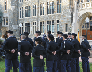 KATHLEEN GUAN/THE HOYA Veteran students, alumni and community members participated in a Veterans Day ceremony on White-Gravenor lawn Wednesday afternoon, which also honored Medal of Honor recipient Charles Rand (MED 1873).