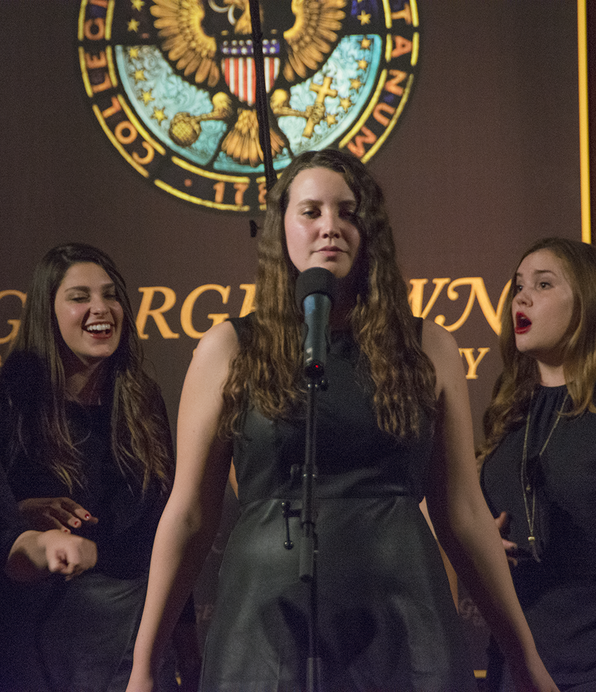 JINWOO CHONG/THE HOYA Tori Forelli (COL '18) performs with the Gracenotes, who closed the show in Gaston Hall last Saturday with a five-song set.