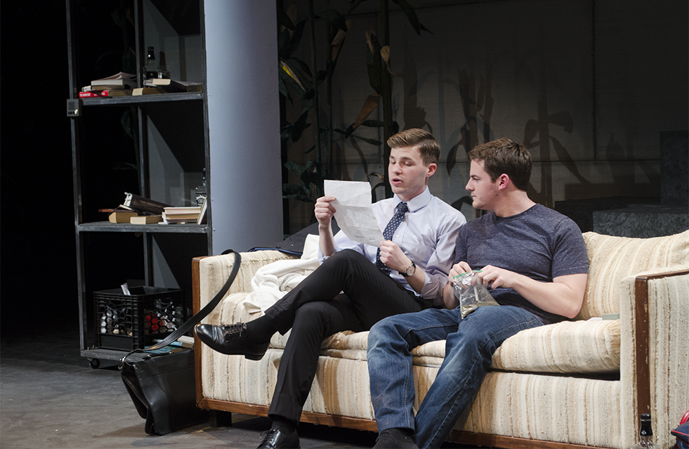 "STANLEY DAI/The Hoya In the Nomadic Theatre's new play, Andrew Walker (SFS '16), left, plays Bruto, a quirky literary agent who persuades his client Tobin Falmouth, played by Greg Keiser (COL '16), to travel to a small town to defend his controversial book, ""The Metal Children."""