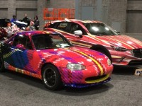 "Professor L. Collier Hyams' ""Sassy Lassie"" tartan Mazda Miata and Zack Engler's (COL '18) ""Hyper"" CX-3 Mazda during the Washington Auto Show setup on Wednesday, Jan. 20. The show highlights artwork from 11 Georgetown students and Hyams."