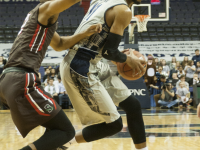 ISABEL BINAMIRA/THE HOYA Senior center and co-captain Bradley Hayes, left, averages 8.7 points per game and leads the team with 6.8 rebounds per game this season.