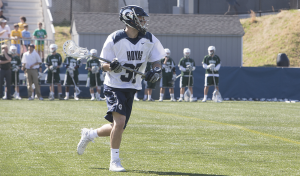 FILE PHOTO: DANIEL KREYTAK/THE HOYA Graduate student midfielder and co-captain Joe Bucci tallied one assist in Georgetown's 16-4 loss to Villanova. Bucci has scored 13 goals and recorded six assists this season, and he is second on the team in points with 19.