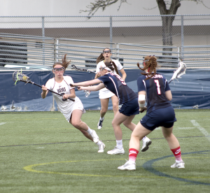 FILE PHOTO: CLAIRE SOISSON/THE HOYA Junior attack Colleen Lovett, left, had one assist to senior attack Corinne Etchison in Georgetown's 13-12 win over Marquette. Lovett has eight goals and five assists this season.