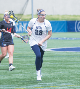 FILE PHOTO: NAAZ MODAN/THE HOYA Senior midfielder Kristen Bandos scored two goals and had one assist in Georgetown's 10-5 win over Cincinnati on Saturday.