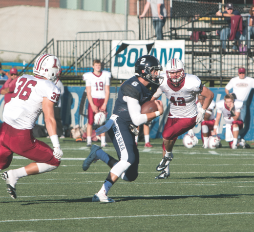 FILE PHOTO: KARLA LEYJA/THE HOYA Junior running back Alex Valles is the team's leading rusher. He has 191 rushing yards this season and has a yards per carry average of 7.1.