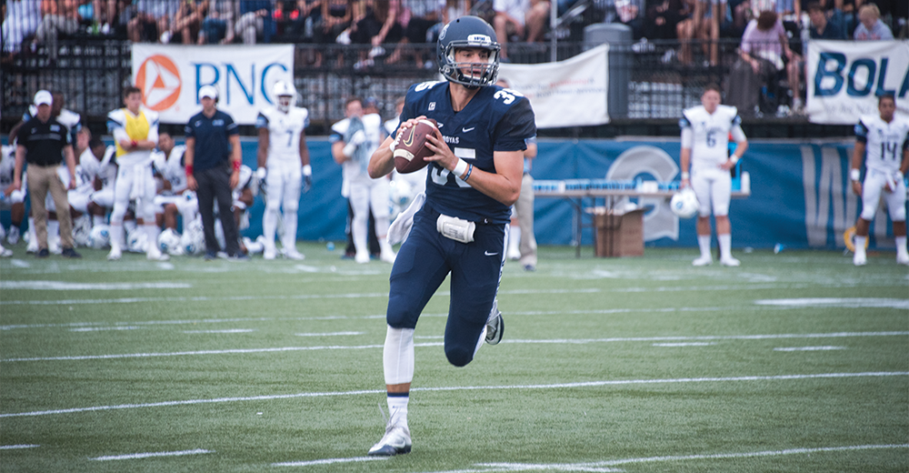 NAAZ MODAN/THE HOYA Senior quarterback and co-captain Tim Barnes completed 16-of-30 passes and threw for one touchdown and 124 yards in Saturday's 17-14 win against Columbia. Barnes also rushed for a team-high 39 yards.
