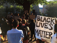 """DANIEL SMITH/THE HOYA Students and faculty gathered in Red Square on Friday to rally against the police brutality that led to the shootings of Terrence Crutcher and Keith Lamont Scott, ending by joining arms to sing """"We Shall Overcome."""""""