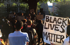 "DANIEL SMITH/THE HOYA Students and faculty gathered in Red Square on Friday to rally against the police brutality that led to the shootings of Terrence Crutcher and Keith Lamont Scott, ending by joining arms to sing ""We Shall Overcome."""