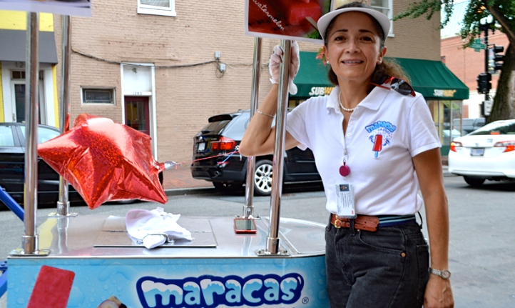 COURTESY MARACAS Julia Padierna-Peralta (SFS '87) stands with a tricycle-cart for her startup Maracas. The company is approaching its two year anniversary next week.