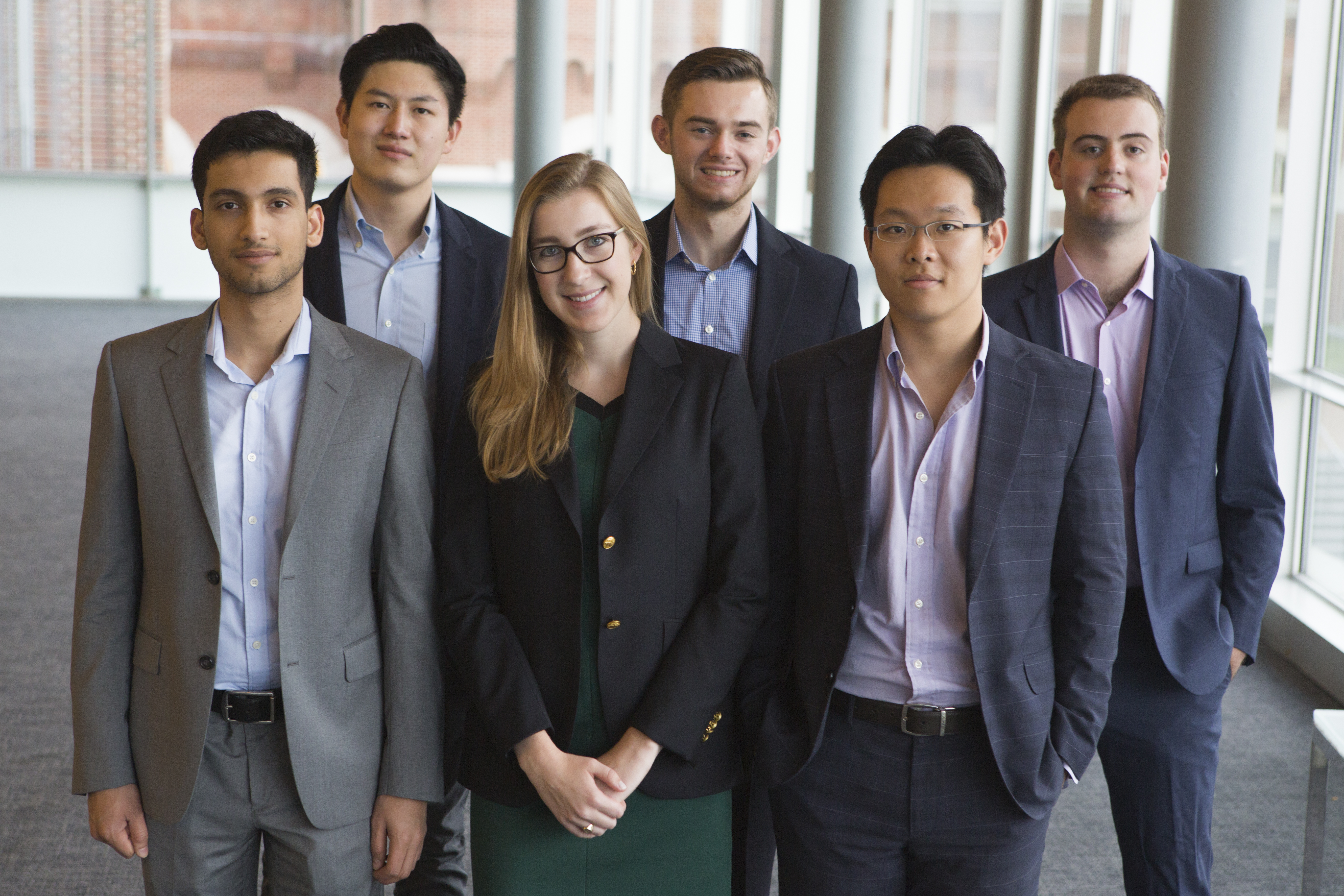COURTESY GEORGETOWN UNIVERSITY PUBLIC REAL ESTATE FUND James McLoughlin, back middle, and Lena Duffield, front middle, are members of the inaugural executive committee of the Georgetown University Public Real Estate Fund.