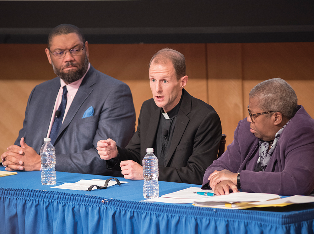 COURTESy georgetown initiative on catholic social thought and public life Slavery, Memory and Reconciliation fellow James Benton, left, history professor Matthew Carnes, S.J., and theology professor Emerita Diana Hayes talked on the panel.