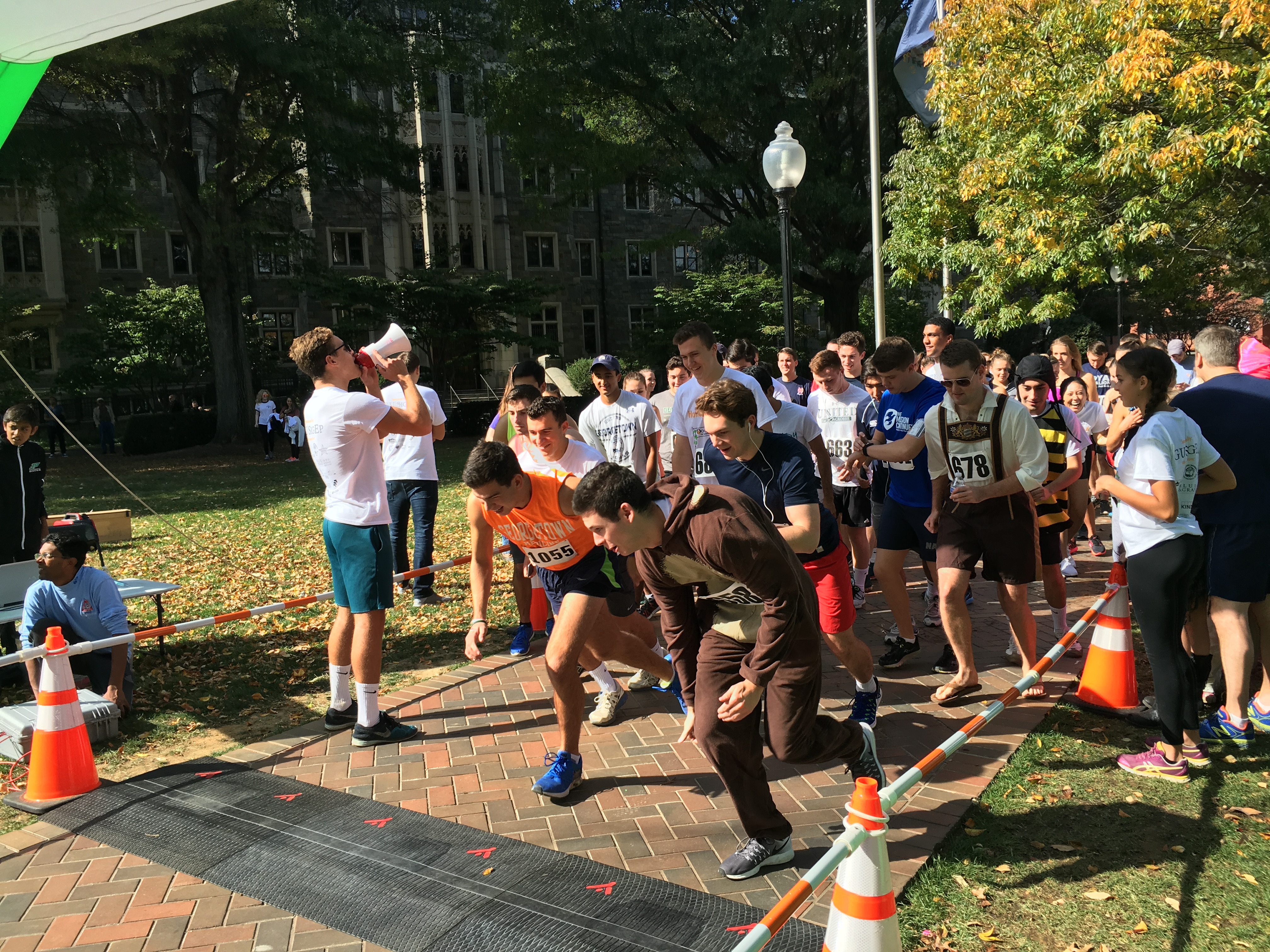COLIN MALONEY/THE HOYA One hundred fifty-five runners took part in a 5K marathon sponsored by Sigma Phi Epsilon to raise almost $9,000 for Doorways for Women and Family, a charity that supports victims of domestic violence.