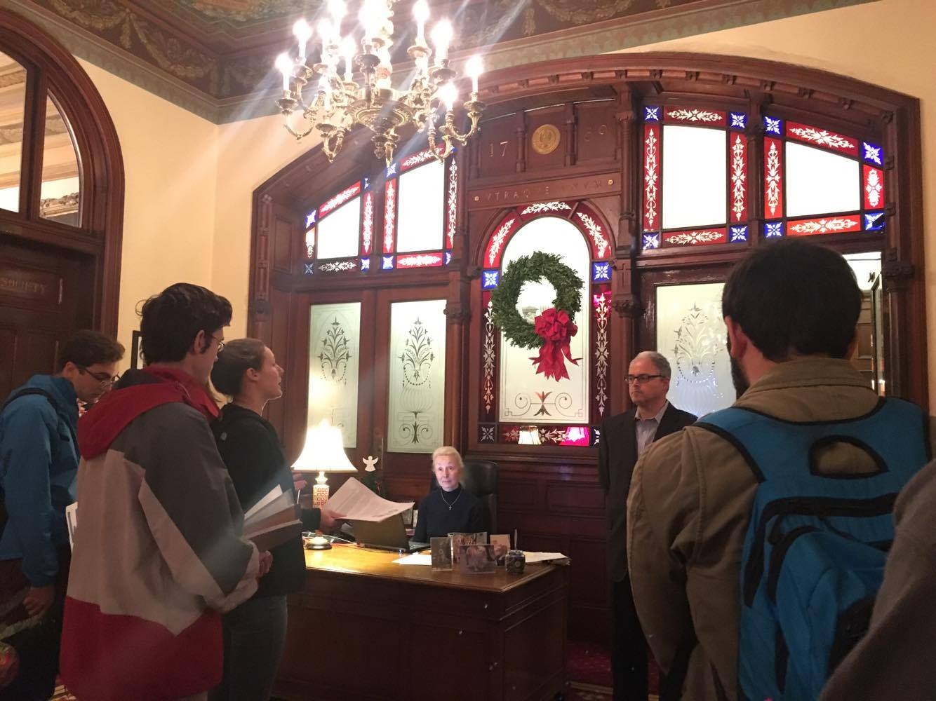 JEANINE SANTUCCI/THE HOYA About 10 students from the Georgetown Solidarity Committee delivered a letter yesterday to Chief of Staff Joseph Ferrara demanding the university end its contract with Nike by the end of business hours today.