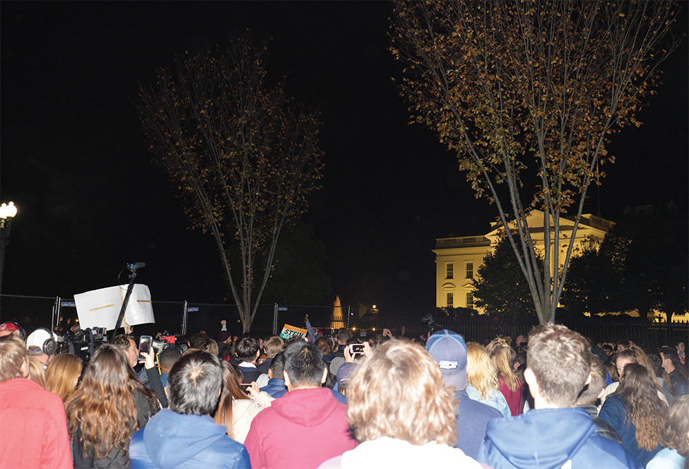 CHRISTIAN PAZ/THE HOYA People gathered outside of the White House lawn to wait for the presidential election results.
