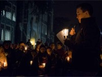 About 200 members of the community attended a vigil in Red Square on Wednesday night in solidarity with students and facutly affected by President Donald Trump's immigration ban.