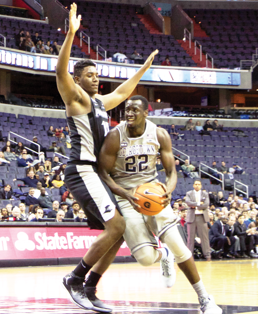 Junior forward Akoy Agau averages 4.4 points per game in addition to 3.7 rebounds per game. (FILE PHOTO: CLAIRE SOISSON/THE HOYA)