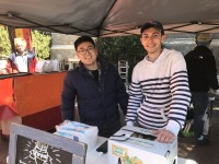 WILLIAM ZHU/THE HOYA Joseph Hwang (MSB '19), left, and Chas Newman (MSB '19) launched their french fries company at the year's first farmers' market.