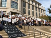 "Jesus Rodriguez/The Hoya Students and faculty protested both Sessions' policies as attorney general and the selective nature of the event by ""taking a knee"" outside the venue."