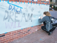 "ALI ENRIGHT FOR THE HOYA The weeklong GUHereToStay campaign featured a ""Dream Wall"" in Red Square, where students wrote messages of support to the undocumented community."