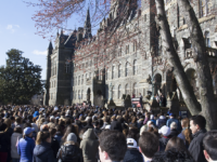 HANNAH LEVINE FOR THE HOYA Hundreds of Georgetown University students, faculty and community members gathered in front of Healey Hall at 10 a.m. Wednesday morning, calling for gun violence prevention in the aftermath of last month's shooting in Parkland, Fla.