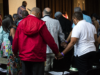 More than 500 descendants of the 272 men, women and children sold by the Maryland Jesuits to save Georgetown reunited over the weekend, pictured here joining in prayer. KARLA LEYJA/THE HOYA