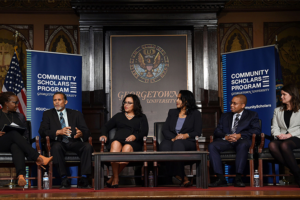 GEORGETOWN UNIVERSITY Center for Multicultural Equity and Access Director Charlene Brown-McKenzie (C '95) (left) facilitated a panel of Community Scholars Program alumni at an event honoring the program's 50th anniversary Oct. 5.