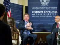 KIRK ZIESER/FOR THE HOYA Senator Mark Warner (D-Va.) warned that the United States' system of capitalism threatens the strength of Western democracy, at an event on Oct. 16.
