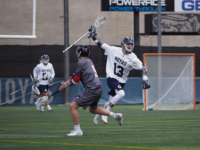 KIRK ZIESER/THE HOYA | Freshman midfielder Zachary Geddes moves by the defender to take the ball up the field.