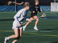 JULIA GIGANTE/FOR THE HOYA| Cradling the ball, junior attack Emily Ehle moves upfield against Towson.