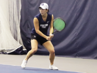 ROCHELLE VAYNTRUB/ FOR THE HOYA | SENIOR RISA NAKAGAWA RETURNS A SERVE IN HER DOUBLES MATCH
