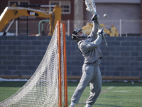 KIRK ZIESER/THE HOYA | A Georgetown goalie goes up for a save during warm-ups. Sophomore goalie Owen McElroy tallied 16 saves in win over Sacred Heart.