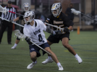 ELLIE STAAB/FOR THE HOYA | Senior attack Dan Bucaro pivots to get away from his defender. Bucaro scored a hat trick in the game against Marquette.