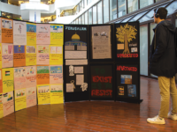SHEEL PATEL/THE HOYA | Students gathered to create a mock wall of art for Israeli Apartheid Week on Monday. The artwork has been displayed in the Intercultural Center Galleria throughout the week.