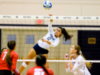 GUHOYAS | Sophomore outside hitter Elissa Barbosa spikes the ball over the net during the Bulldog Invite.