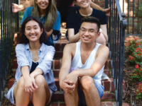 Current and former members of the Asian-Pacific Islander Leadership Forum sit in front of the Asian American Hub for Organizing, Movement and Empowerment (HOME) house. The Magis Row townhouse was opened this year, marking the first residential space for Asian American students on campus.